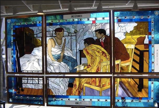 Man on the Bed stained glass window at the Akron intergroup office (via akronaa.org)