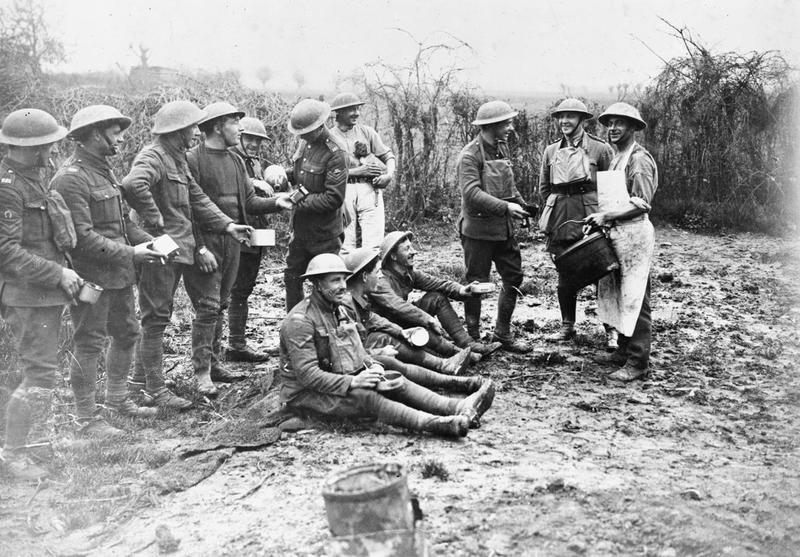 Rum and tea were often issued mixed together, as seen in this 1918 photograph of artillerymen from the 55th Division. © IWM (Q 344)
