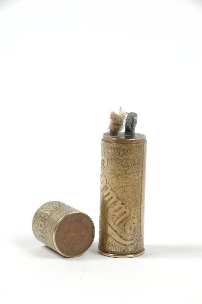 "Lighters were a common form of trench art. This lighter, emgraved with ""Somme 1916,"" is made from a shell casing. Source: http://www.europeana1914-1918.eu/en/contributions/16461"