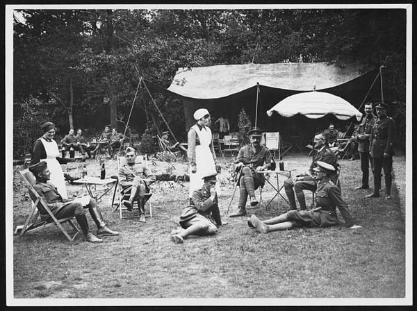 This photograph shows American officers (left) and British officers (right) drinking beer with British nurses behind the lines in 1918. Because the American military did not issue alcohol to its troops, drinking behind the lines was the only option Doughboys had. Image Credit: National Library of Scotland Image (79) N.536